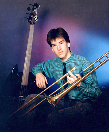 Jonathan posing with instruments at age 17